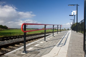 Red tubular railing for Dutch railway stations