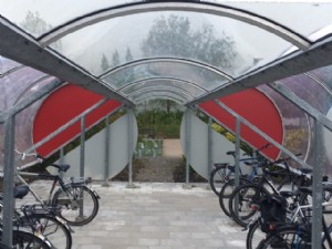 Spacious bicycle shelter with covered walkway
